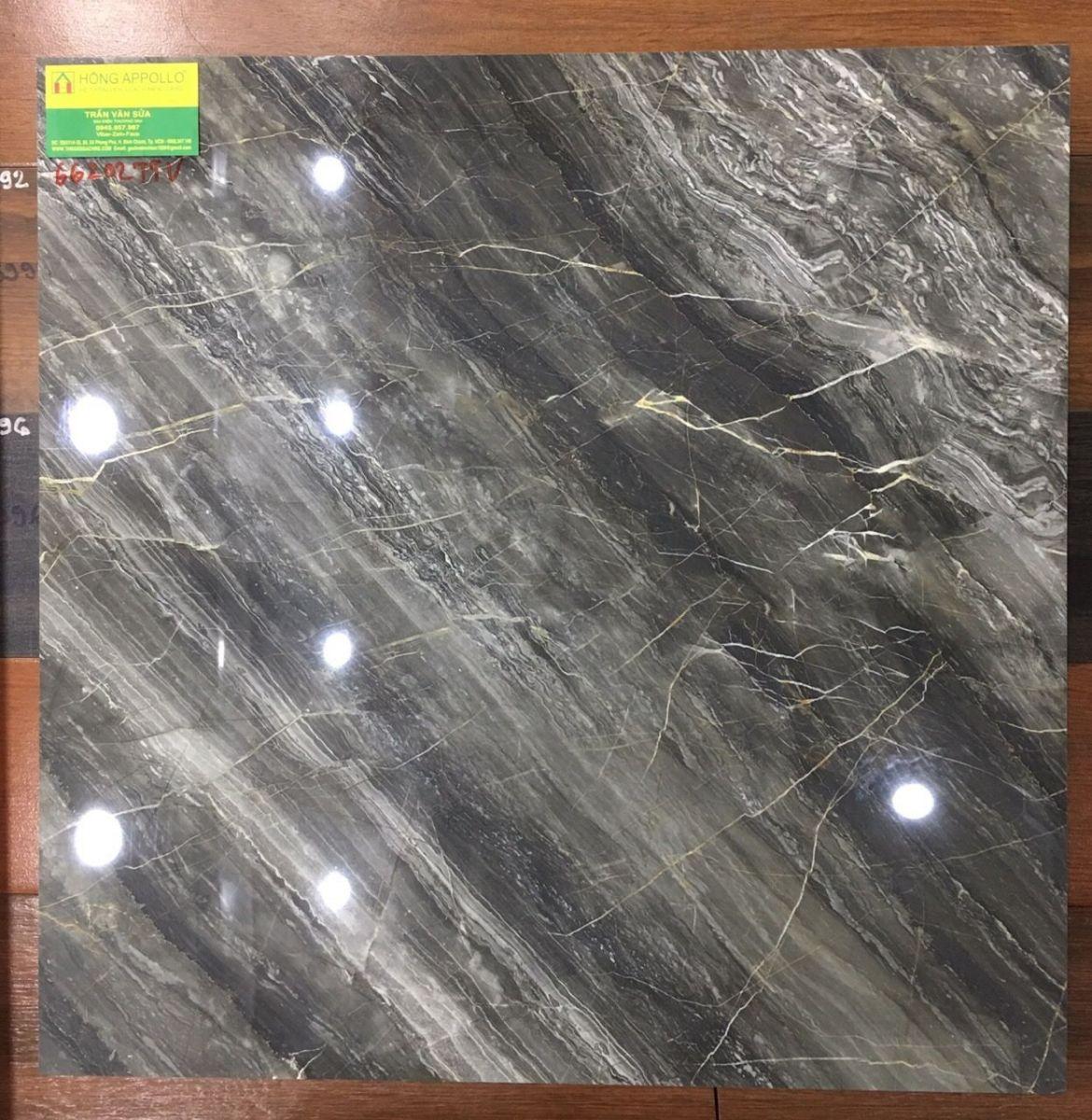gạch bóng kiếng  60x60 đen vân vàng